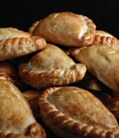 The pasty was taken to work by Cornish tin miners all around the world in the 19th century.  In our town, BUTTE, MT, Pasties are famous!  The city was built around the deep copper mines, & many Irishmen came to Butte to work in them.  The Irish have their own variation of this wonderful 'meat, potato, & onion pie,' which can be held in the hand.