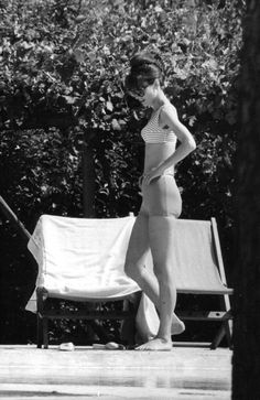 """thefashionofaudrey:  """"The actress Audrey Hepburn photographed by Elio Sorci in the outdoor area (near the pool) of her rented villa outside Paris (France), in July 1962.  Audrey was wearing:  • Bikini: Givenchy Boutique Paris (of the collection for the..."""