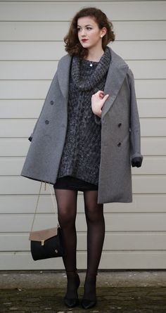 Shop this look on Lookastic:  http://lookastic.com/women/looks/overcoat-and-cowl-neck-sweater-and-heels-and-crossbody-bag-and-mini-skirt/1948  — Grey Coat  — Charcoal Cowl-neck Sweater  — Black Leather Pumps  — Black Leather Crossbody Bag  — Black Mini Skirt