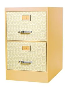<i>HGTV Magazine</i> gives the simple how-tos of transforming a dingy filing cabinet into a chic office organizer.