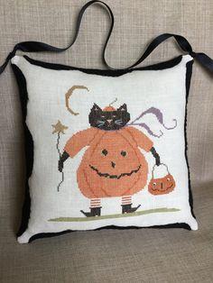 Completed primitive cross stitch Cat Tricks by Rishastitchery
