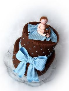 Baby boy cake. I like just the chocolate frosting and the blue dots...ok, the bow is cute too.