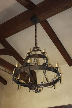 Hand forged iron chandelier made by www.haciendalights.com