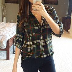 "Olive and navy plaid top Do not buy this listing ⚠️ Comment with your size and I'll make a listing for you.                                      The perfect fall plaid blouse. Wear tucked into jeans or over leggings. Navy and olive button up with rolled tab sleeves, polyester. No trades, no offers, price is firm. I'm 5'5"" modeling a small. Tops Button Down Shirts"