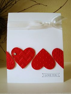 Stampin' Up! ... handmade Valentine card ... Whisper White base with die cut hearts  from Real Red ... luv the different embssing folder textures on the hearts ...
