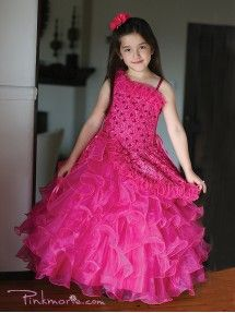 A stunning pageant dress for your little precious girl by Angels Garment. This one-shoulder gown features intricately detailed embroidery and sparkling sequins. The skirt features rows & rows of organza ruffles. This perfect dress will make your daughter Organza Dress, Tulle Ball Gown, Satin Dresses, Elegant Dresses, Lace Dress, Sequin Flower Girl Dress, Cheap Flower Girl Dresses, Girls Pageant Dresses