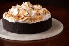 Chocolate Cream Pie with its mile high Swiss Meringue and cookie crust is the kind of pie you remember from childhood, just cranked up a notch.