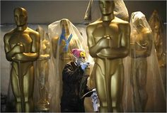 We're proud to have been involved with the Academy Awards throughout the years in the painting of the decorative Oscar Statues and the Dolby Theatre (formerly Kodak). Here, the statues are being given coats of gold metallic paint by decorative scenic artists.