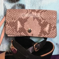 Coach Wallet NWT authentic Coach wallet/ wristlet.  Snakeskin-like leather gives it a unique appeal.  Compact and slim, yet will hold your cash, card and coins.  ❌Trades ✅Offers Accepted Coach Bags Wallets