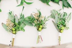 Green Boutonnieres with Eucalyptus and Hypericum Berries