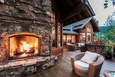 Rustic cabin porch with a beautiful fireplace!