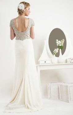 A beautiful vintage inspired gown in heavy crepe. Embellished with an array of sparkling crystals and pearly beads. The beading continues over the shoulder to frame a stunning low cut back. Crepe Wedding Dress, Prom Dresses, Wedding Dresses, I Dress, Dress Collection, Mother Of The Bride, Vintage Inspired, Bridesmaid, Gowns