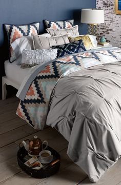 The navy and coral chevron print totally lends a modern touch to this dreamy bedding.