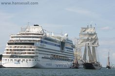 Traditional sailing ships meet cruise liners on the river Warnow/Rostock.
