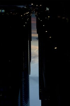 """archatlas: """" Buildings Made of Sky Photographer Peter Wegner captures another city in the urban canyons between the buildings. It's invisible, the city no one built. In this city, the buildings are. Architecture Tumblr, What Is Miss, Rooftop, Nyc, Clouds, City, Image, Buildings, Skyscrapers"""