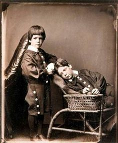 """This is not postmortem.  It is a photo taken by Lewis Carroll, the author of """"Alice in Wonderland"""".  He took many photos of children. Carroll took fewer pictures of boys, such as this 1876 photograph of Brook and Hugh Kitchin. Collection of Prentice and Paul Sack   See: http://www.sfgate.com/entertainment/article/In-the-eye-of-the-beholder-Lewis-Carroll-2815012.php#photo-2213957"""