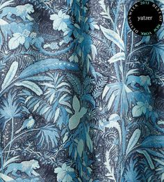 TheLIONESSlinen fabric fromBeacon Hill's Midnight Garden print collection.