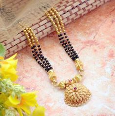 Explore the trendy collection of Gold Mangalsutra design at Waman Hari Pethe Sons. Gold Mangalsutra Designs, Gold Jewellery Design, Gold Jewelry, Beaded Jewelry, Beaded Necklace, Diamond Jewellery, Gold Necklace, Jewellery Rings, Mangalsutra Simple