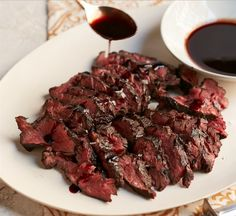 Beef up your hanger steak with a tangy red wine marinade and sauce, courtesy of chef Floyd Cardoz.