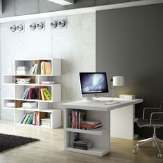 The super-streamlined Multi Storage Desk offers a clean and distraction-free form, with simple shelves tucked away on the sides of the legs. It's available in a variety of finishes to suit any environment.