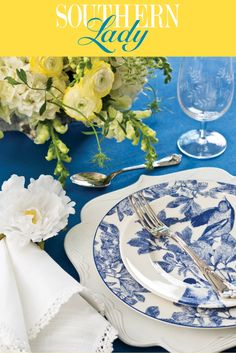 A pristine palette of white and blue beckons guests to gather around an elegant table set for afternoon fellowship.