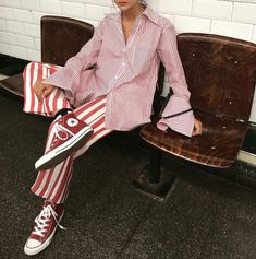 Love this pink button front shirt worn with red and white striped pants and red converse high tops - the coolest spring street style Red Converse, Converse All Star, Converse Sneakers, Converse High, Candy Stripes, Pink Stripes, Looks Style, Style Me, Funky Style