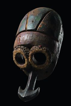 Nigeria, Mumuye wood, polychrome paint, elongated head with large tubular eyes, framed by encrusted mass inset with abrus beans (mainly missing), anchor-shaped protruding mouth, pierced around the rim, rep. (breakage at the lower rim), cracks, small missing parts, slight traces of abrasion, base  H: 43 cm H: 16.9 inch    Read more: http://www.tribal-art-auktion.de/en/catalogue185/d10_321/#ixzz3BofpJXEJ