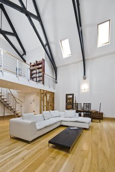 It really doesn't get more open concept than this home.  The dramatically tall ceiling makes it easy to create a sizable loft space that barely seems to encroach the rest of the room.  Below is an image depicting the staircase behind the kitchen to the loft.
