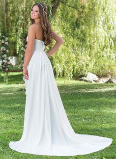 A beautiful gown for any destination. This sweetheart crinkle chiffon straight gown has a natural waistline, beaded lace bodice, cascading asymmetric ruffle, and a sweep train. https://www.sweetheartgowns.com/sweetheart/6149