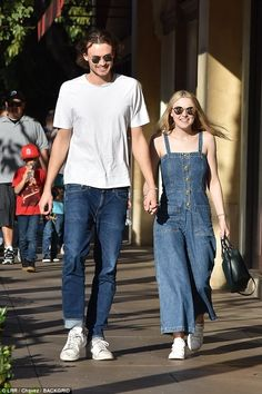 Good together: The cosy couple were stylishly in sync with one another, both donning denim and a pair of mirrored sunglasses