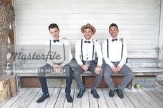 14ff0695934 Portrait of groom and two male friends sitting on bench