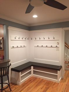 L shape, flat back Mudlocker mudroom entranceway bench. Built in Mud locker bench with shelving