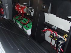 Nice battery and power setup behind the rear seats of this Toyota Tacoma.