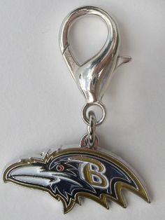 Officially Licensed NFL Team Charms Perfect gift for four-legged fans of the  Baltimore Ravens! These jewelry-quality charms are crafted from antiqued, lead-safe pewter, and are hand- enameled.   Size: 1 1/8 x 1 1/2 in.   Made in the USA