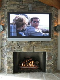 Change the existing chimney breast to stone clad, inset boiler stove low to ground so that tv can be mounted above with decent viewing angle. Need a storage solution for logs? Ledge Stone Fireplace, Stone Fireplace Designs, Tv Over Fireplace, Stacked Stone Fireplaces, Fireplace Pictures, Rock Fireplaces, Fireplace Ideas, Fireplace Makeovers, Basement Fireplace