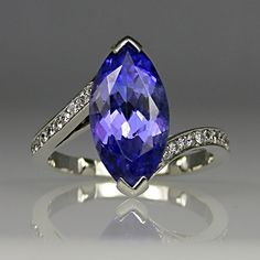Tanzanite and diamond ring in platinum.