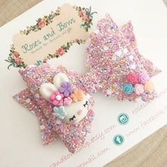 Beautiful Pastel Easter Bunny Glitter Bow Material: Made from chunky glitter fabric and a clay charm and finished with tiny resin flowers. Size: The bow measures approximately 8cm and is in my dolly bow shape. Clip or headband (see photos): An alligator clip lined with ribbon.
