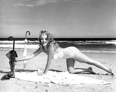"""Marilyn at Tobey Beach - Long Island . Photo session with umbrellas. """"Red umbrella with white dots"""". Photo by Andre de Dienes. Marilyn Monroe, Classic Hollywood, Old Hollywood, Hollywood Glamour, Long Island, Pin Up, Parasols, Umbrellas, Joe Dimaggio"""