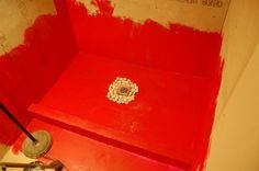 Creating a tile shower base with concrete and redguard water proofer