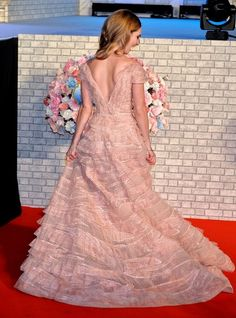 Lily James Photos Photos - Actress Lily James and director Kenneth Branagh attend the premiere of 'Cinderella' on April 8, 2015 at Roppongi Hills in Tokyo, Japan. - 'Cinderella'  Premiere in Tokyo