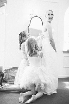 Flower girls helping the bride get ready.