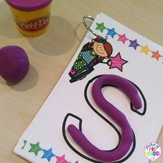 Making letters with playdoh on letter mats helps students learn letters and…