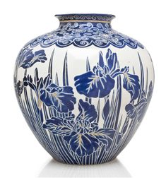 A large earthenware jar from the Meiji period with a blue enamel Shimazu crest