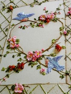 Ribbon work flowers and sweetly embroidered bluebirds.