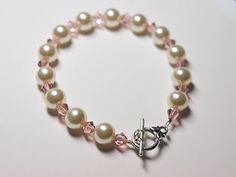 DIY Glass Pearl and Swarovski Crystal Bracelet. Step by step tutorial. This is a fairly easy project. It's great if you're trying to learn simple jewelry making techniques.