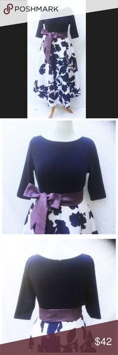 "New Eshakti Floral Fit & Flare Dress XL 16 New Eshakti mixed media fit & flare floral dress  XL 16Measured flat: Underarm to underarm: 46"" Waist:  44"" Length: 60"" Sleeve: 21 1/2"" Eshakti size guide for XL 16 bust: 51"" Cotton/spandex, woven jersey knit bodice, medium stretch, back zipper. Seamed waist w/sash tie belt. Flared midi skirt w/ side seam pockets. Lined in polytaffeta. Skirt: Polyester, woven dupioni, high sheen, light textured slubs. Dry clean New w/ cut out Eshakti tag. eshakti…"