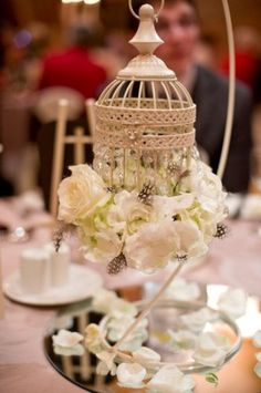 Vintage birdcage to hold flowers on tables