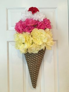 ITEM DESCRIPTION This ice-cream wreath screams summer! Layers of floral ice-cream in lemon sherbet, pink strawberry, and white whipped cream with a cherry on top sit on top a burlap sugar cone. DIMENSIONS: Measures approximately 24 long by 15 wide. POSSIBLE SUBSTITUTIONS: Each item in my shop is handmade and unique. The item you receive will not be the exact one pictured, and there may be slight variations, including minor changes in exact silk flowers used, but the overall effect will be…