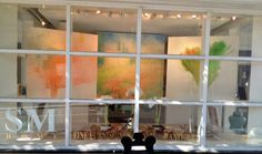 """SM Home Gallery October 2014 Window featuring Penny Putnam, Up in the Air, Mixed Media on Canvas, 40"""" x 40"""", Margaret Bragg, Tuscan Farmhouse, Acrylic on Canvas, 48"""" x 48"""", Penny Putnam, Green Tease, Mixed Media on Canvas, 40"""" x 40"""" www.sandramorganinteriors.com"""