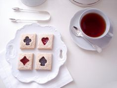 Aces, spades, clubs, and hearts - Alice inspired cookies